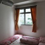 Kamar tidur utama NH Apartment